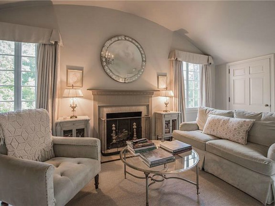 Sitting area with fireplace in bedroom of an elegant historic home with Old World style and beautifully classic European inspired interiors in Marietta Georgia was built for the Kennedy-DuPre family. . See more  English Tudor Interior Design Inspiration from this European Country Master Suite & Dining Room Design Inspiration on Hello Lovely Studio.