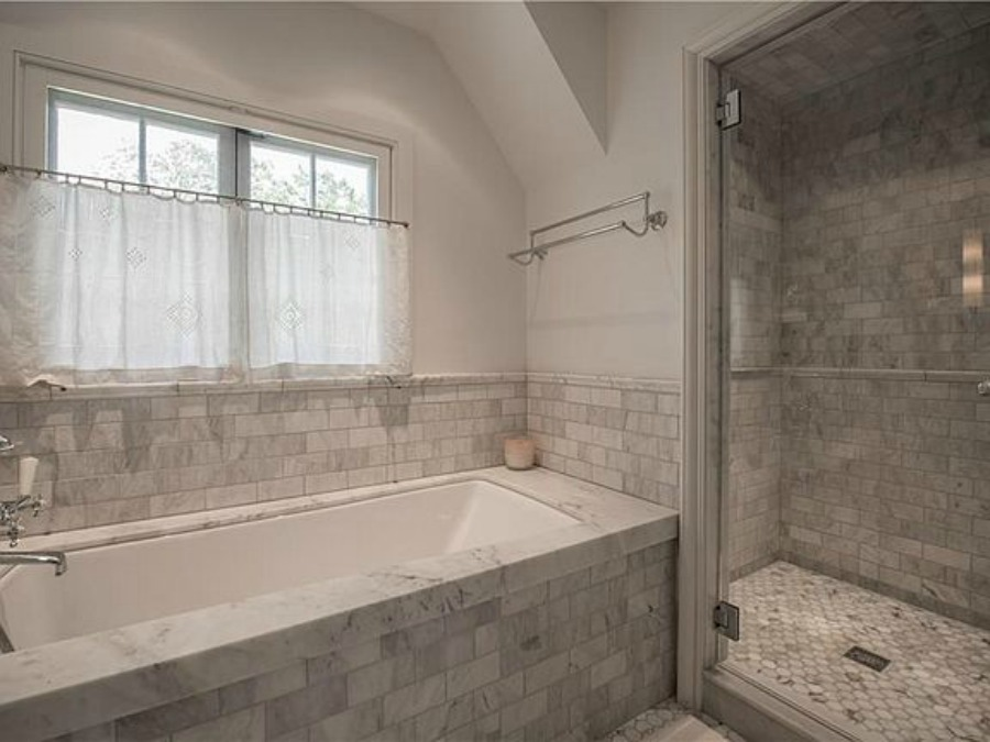 Luxurious marble bathroom in an elegant historic home with Old World style and beautifully classic European inspired interiors in Marietta Georgia was built for the Kennedy-DuPre family. . See more  English Tudor Interior Design Inspiration from this European Country Master Suite & Dining Room Design Inspiration on Hello Lovely Studio.