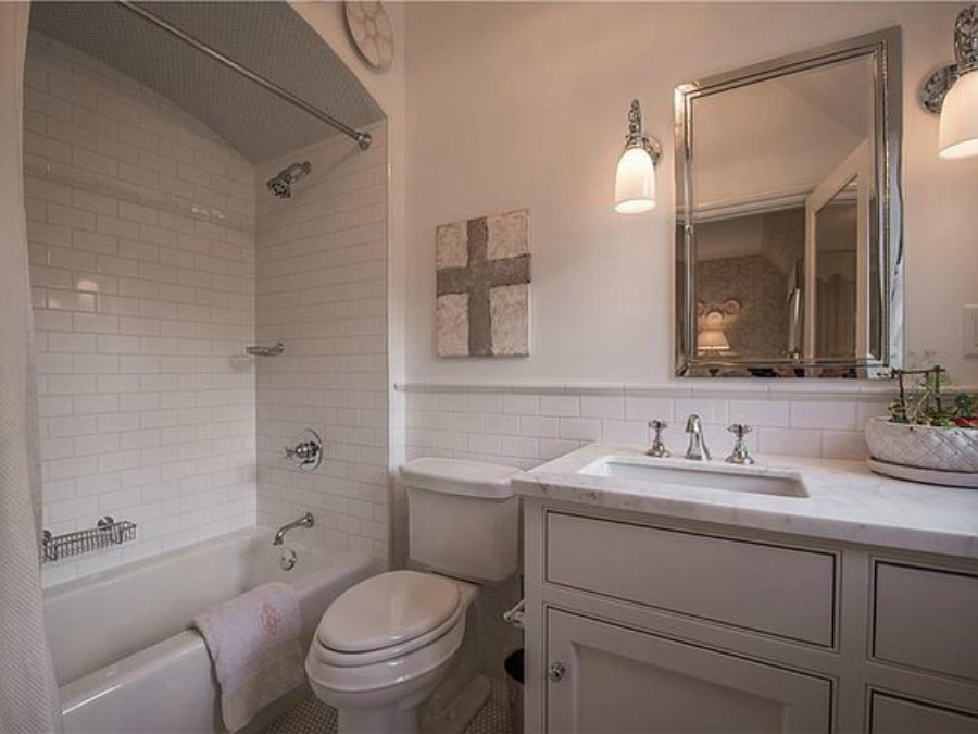 Bathroom in an elegant historic home with Old World style and beautifully classic European inspired interiors in Marietta Georgia was built for the Kennedy-DuPre family. See more in Traditional Style House Tour: 1935 English Tudor on Hello Lovely Studio.