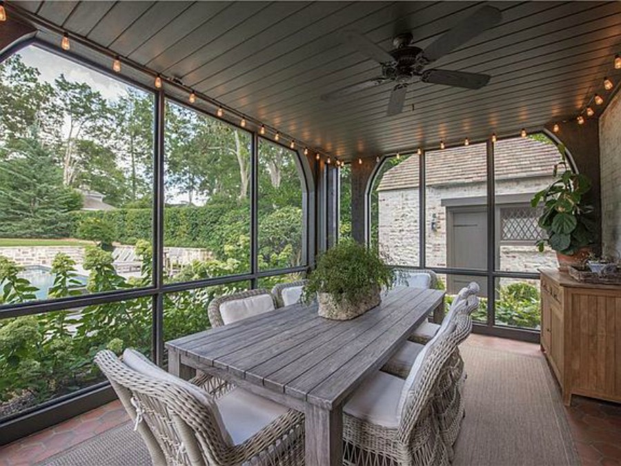 Screen porch at an elegant historic home with Old World style and beautifully classic European inspired interiors in Marietta Georgia was built for the Kennedy-DuPre family. See more in Traditional Style House Tour: 1935 English Tudor on Hello Lovely Studio.