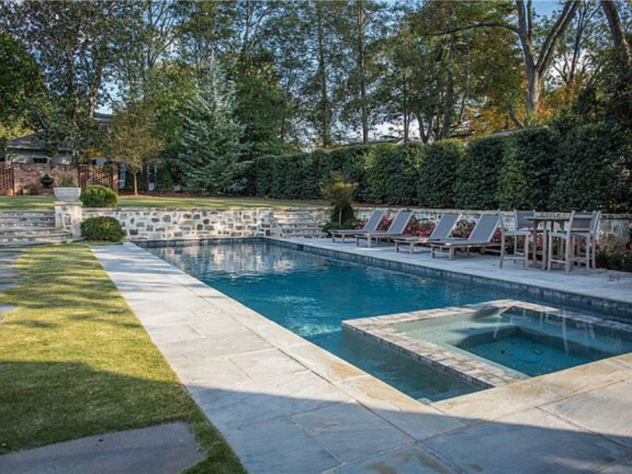 Pool at an elegant historic home with Old World style and beautifully classic European inspired interiors in Marietta Georgia was built for the Kennedy-DuPre family. See more in Traditional Style House Tour: 1935 English Tudor on Hello Lovely Studio.