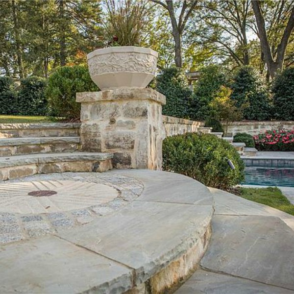 Elegant stone patio at an elegant historic home with Old World style and beautifully classic European inspired interiors in Marietta Georgia was built for the Kennedy-DuPre family. See more in Traditional Style House Tour: 1935 English Tudor on Hello Lovely Studio.