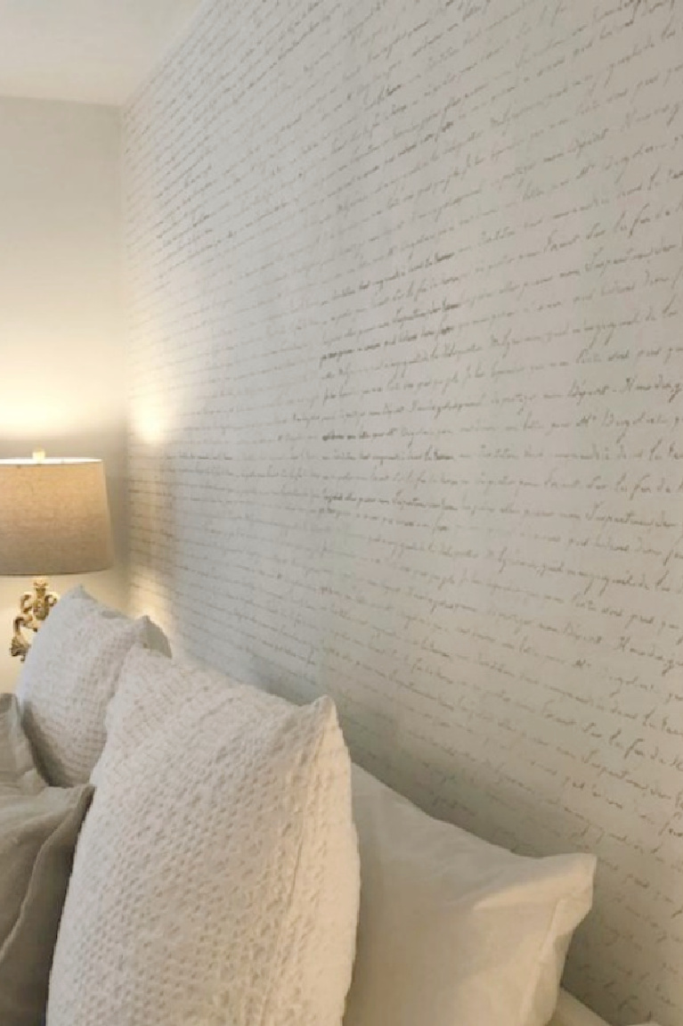 DIY French Script Stenciled Wall - Hello Lovely Studio. #stencils #frenchscript #accentwall #statementwall #diy #homedecor #bedroomdecor