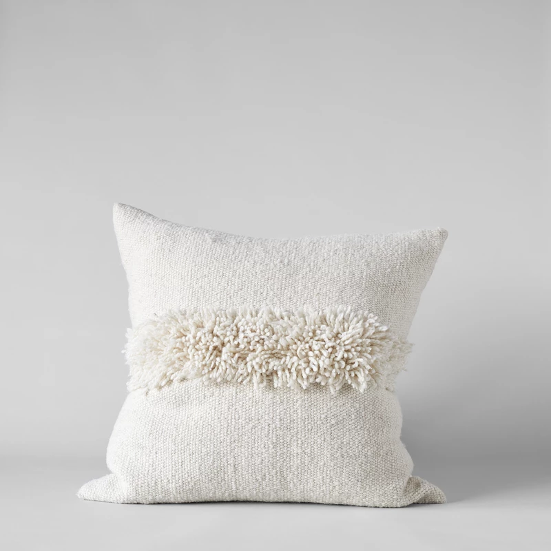 Puna Handwoven ivory pillow and 25 Beautifully Handmade Decor Finds for Home to help you feather your nest and also inspire your interior design schemes.