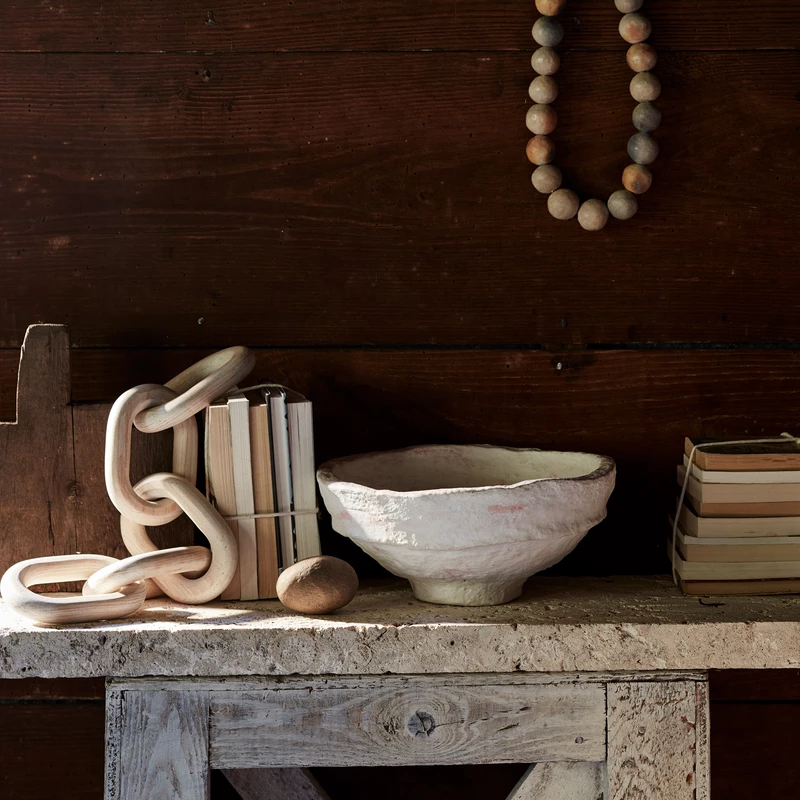 Rustic vignette with handmade paper mache bowl and clay beds from Bloomist.