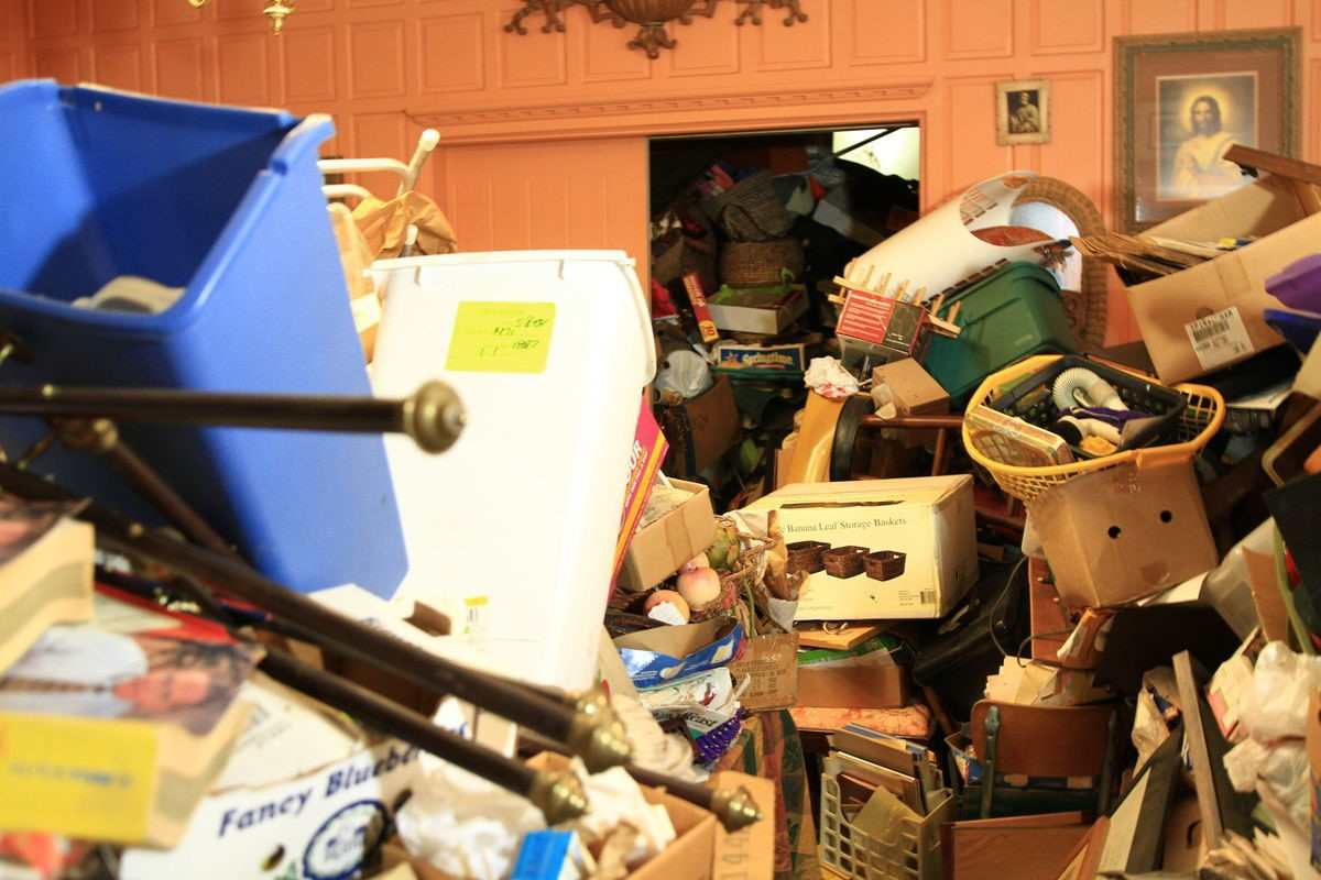 Julian Price Mansion on 'Hoarders' before photo of kitchen piled high with stuff.
