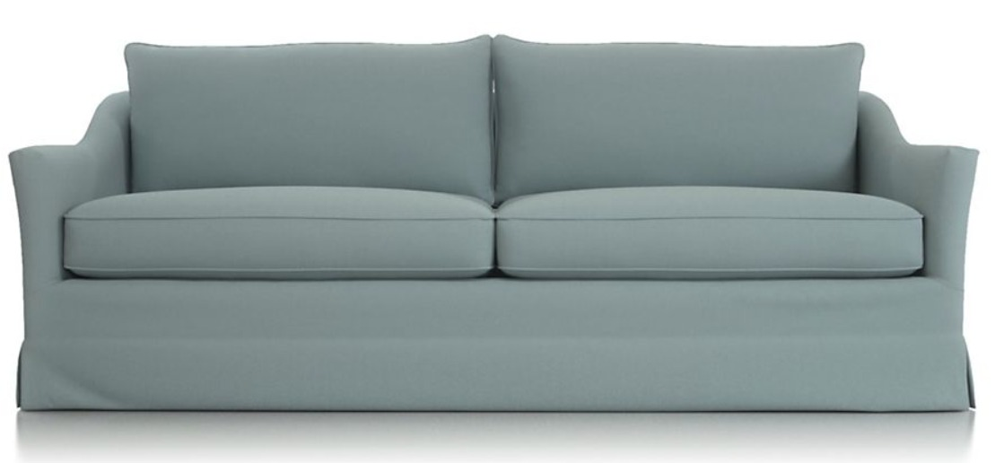 Keely sofa from Crate and Barrel ln a beautiful blue upholstery.
