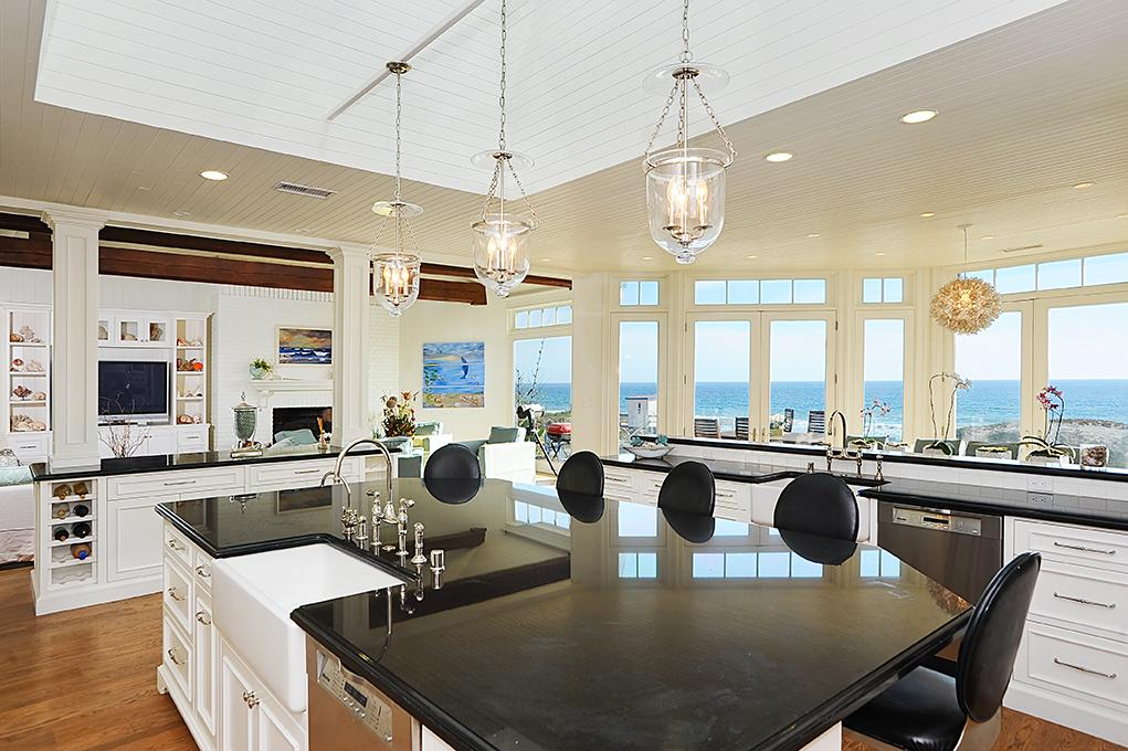 Kitchen in Madeline's beach house in Big Little Lies is a vacation rental in Malibu...come see the oceanfront house tour with Big Little Lies: Madeleine's Beach House Photos! #reesewitherspoon #biglittlelies