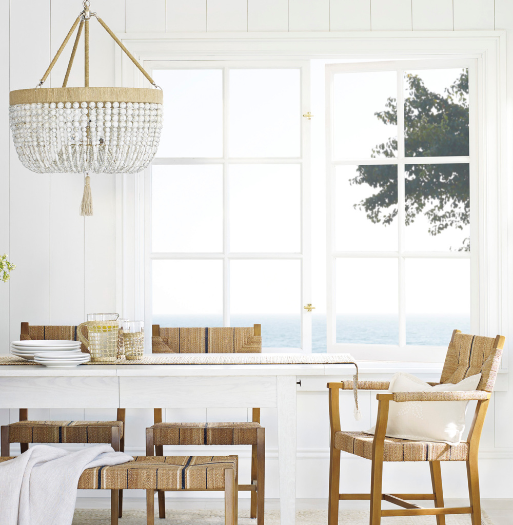 Beach house dining room with Malibu chandelier over white table - Serena & Lily. #beachhouse #diningrooms #chandelier