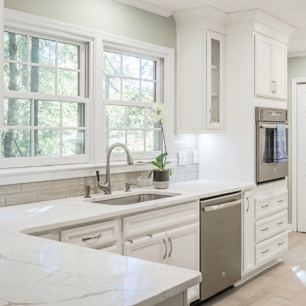 Beautiful kitchen design with white cabinets and stainless appliances by Marsh Kitchens on Hello Lovely.