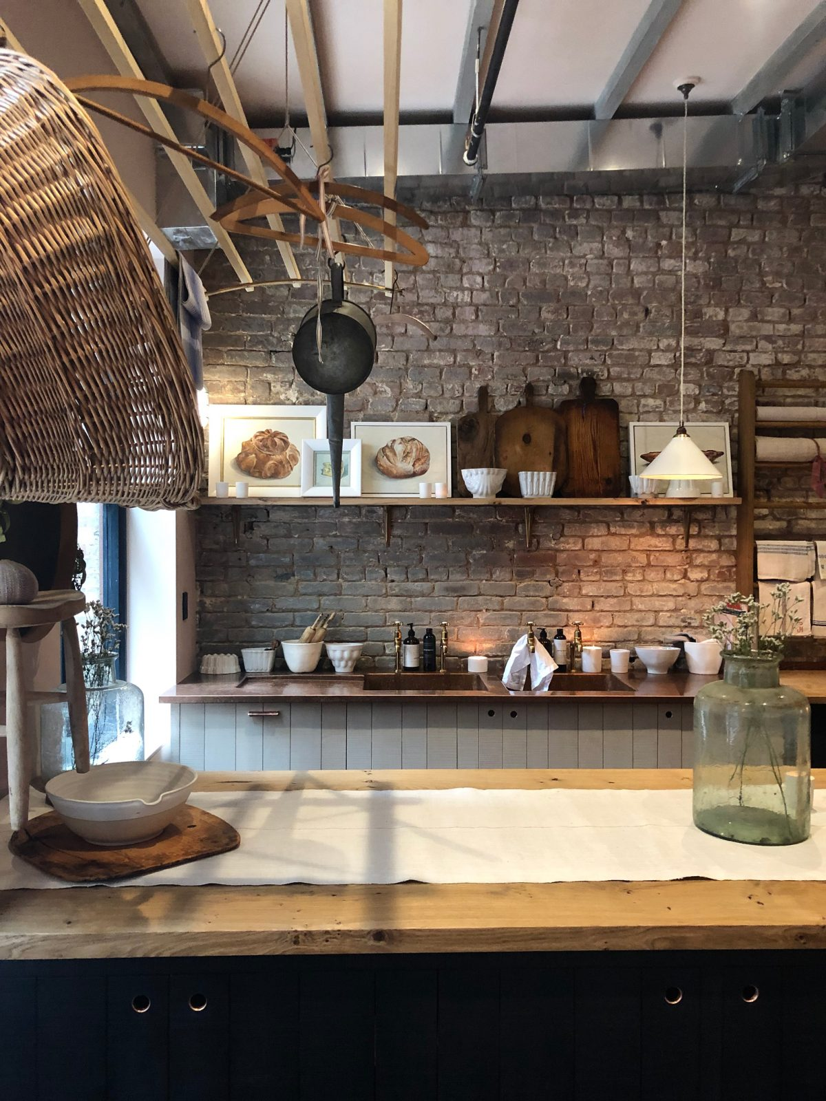 Beautifully rustic European country style kitchen design details in deVOL's Bond Street New York showroom. #rustickitchen #devol #europeancountry #kitchendesign #bespokekitchen