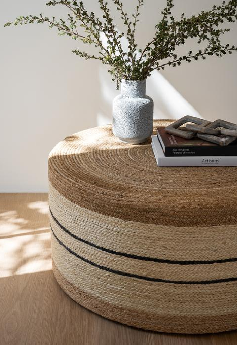 Round woven ottoman (Brynlee) by McGee & Co. makes a perfect rustic, neutral decor statement in a variety of interiors.