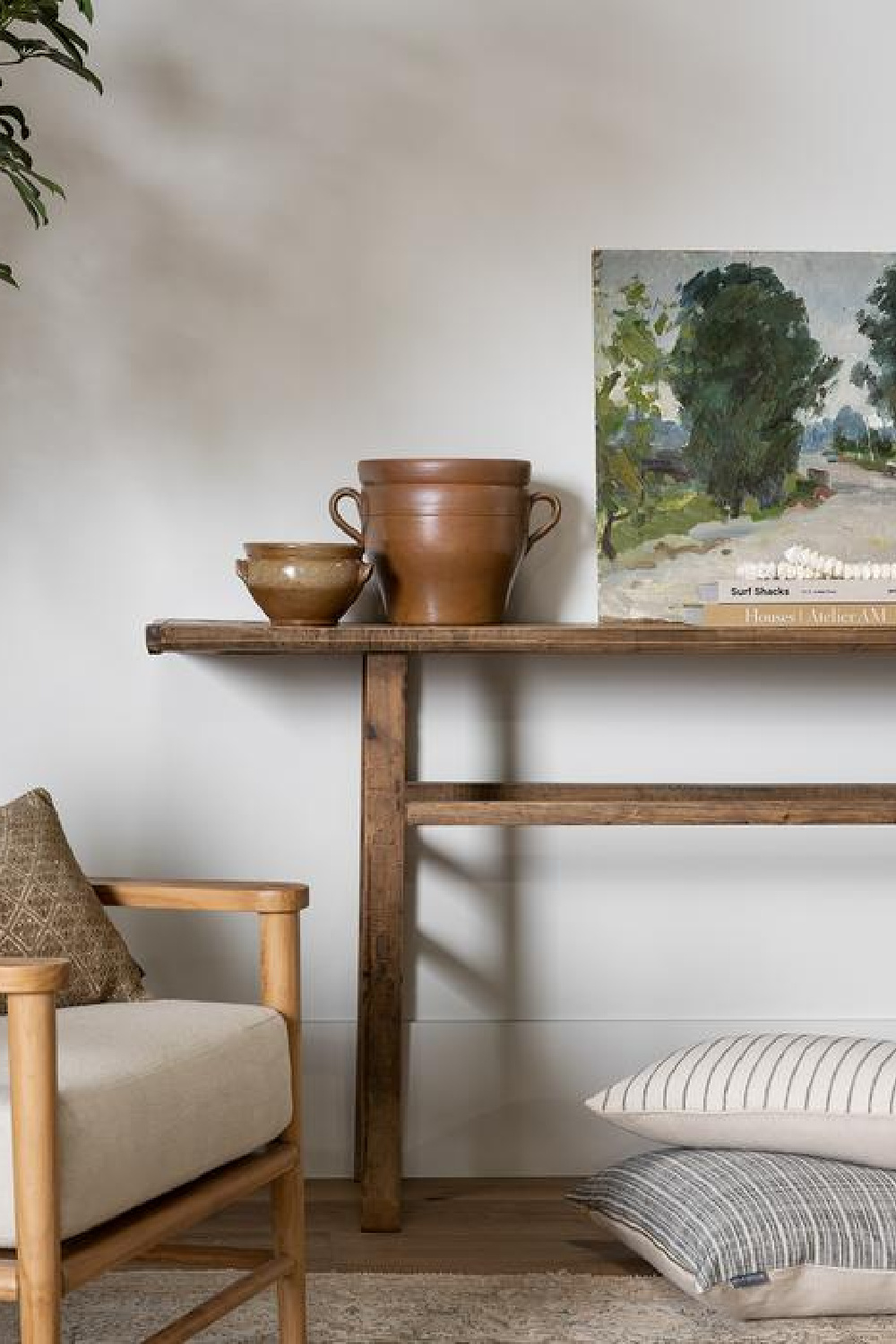 Vintage French handled jug on a console table with painting - McGee & Co.