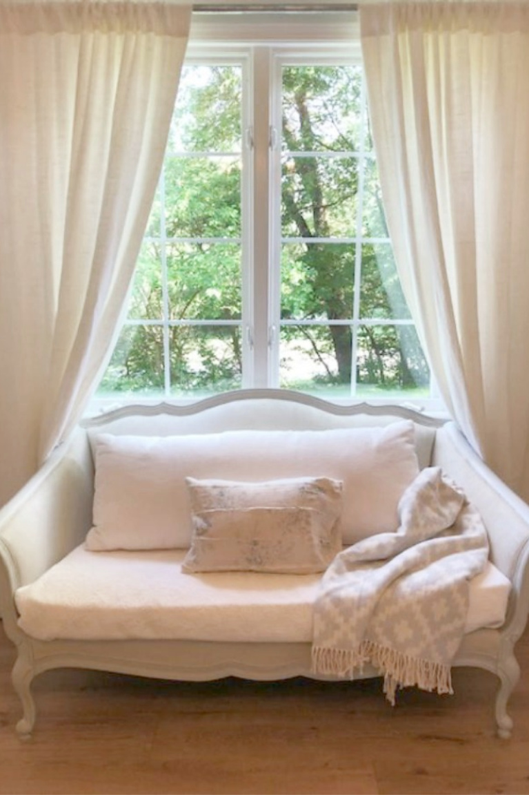 White Belgian linen drapes and a French settee in our French inspired cottage. #hellolovelystudio #frenchcountry #whitelinen #frenchsettee #interiordesign #europeancountry
