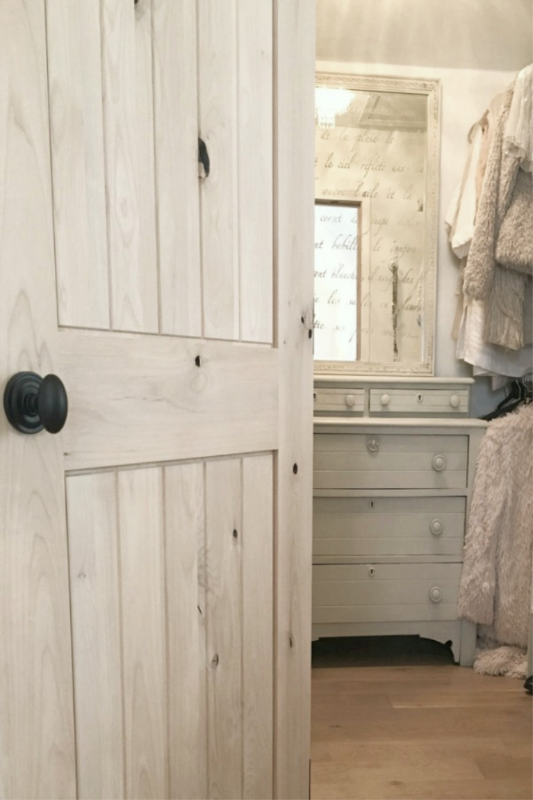 Knotty alder interior door with bronze hardware opening to my closet with Victorian painted dresser. #hellolovelystudio #knottyalder #interiordoors #rusticdecor #frenchcountry #interiordesign
