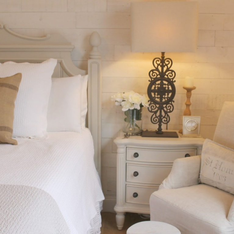 Serene French country cottage style bedroom with Stikwood Hamptons accent wall and white oak flooring. #hellolovelystudio #bedroomdecor #europeancountry #frenchcountry #frenchnordic #whitebedrooms #stikwood #hamptons #serenedecor