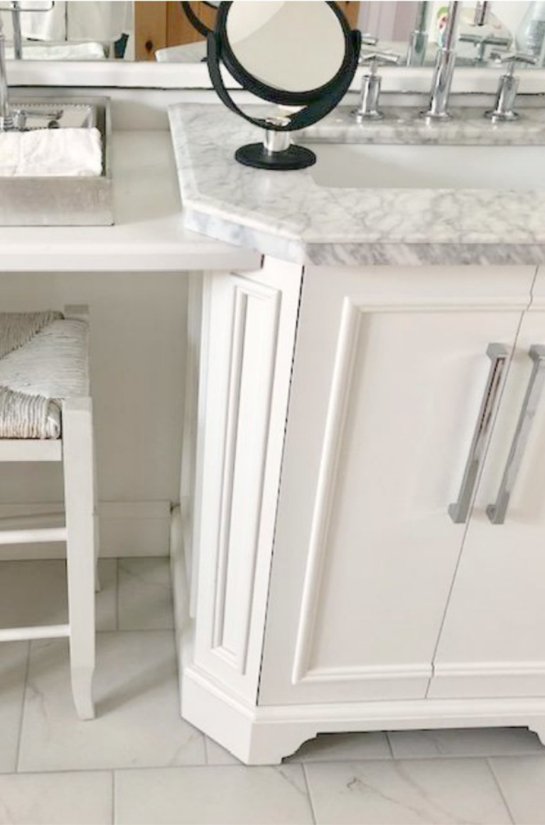 Detail of white vanity with carrara marble top in our French country bathroom. #hellolovelystudio #bathroomvanity #frenchcountry