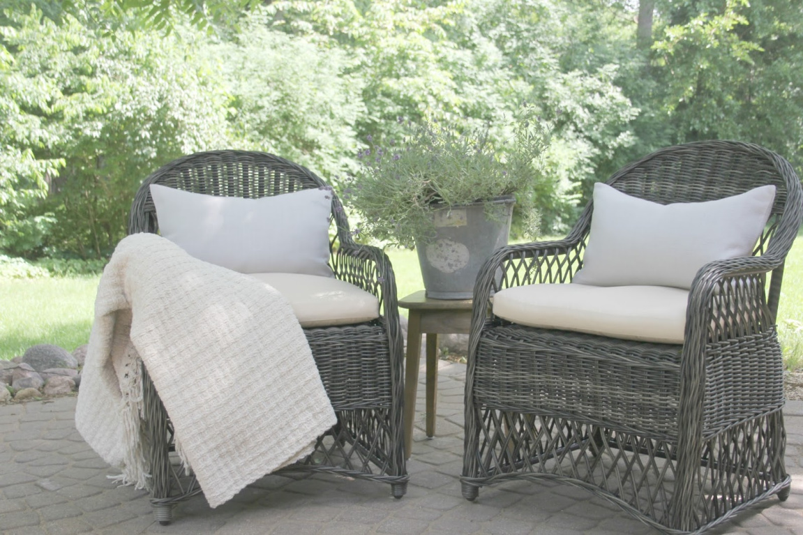Grey rattan patio chairs with ivory cushions and light grey Belgian linen lumbar pillows. #hellolovelystudio #patiochairs #europeancountry #patiofurniture #outdoorfuniture #belgianlinen