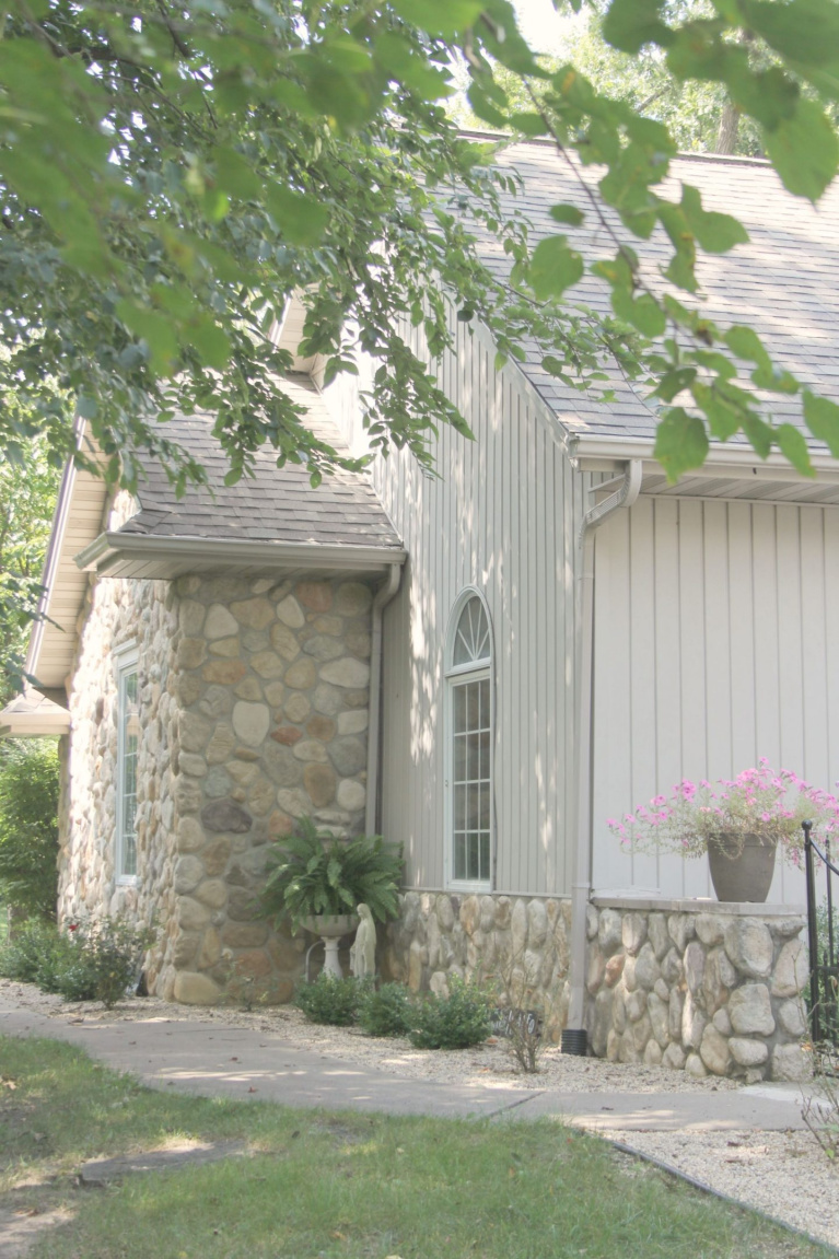 River rock stone accents on our European country inspired cottage exterior. #hellolovelystudio #cottagedesign #houseexterior #rivercottage #riverrock