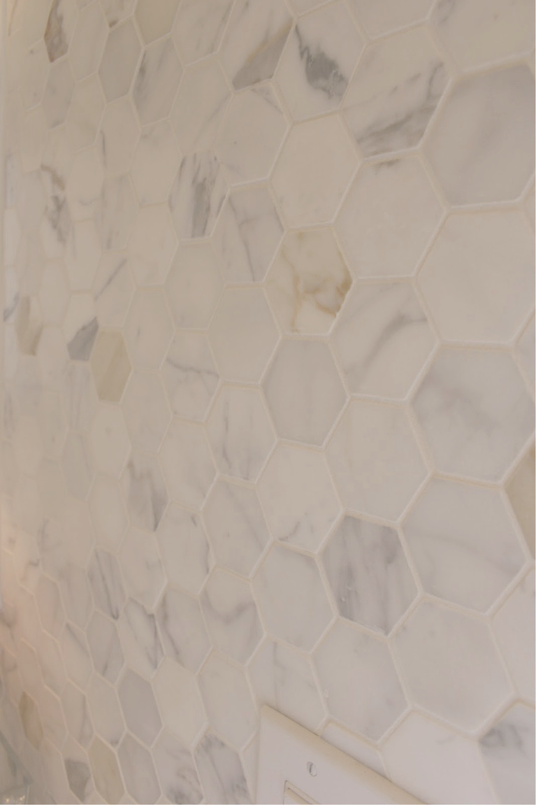 Calacatta gold marble hex tiles on statement wall of our kitchen - Hello Lovely Studio. #calacattagold #marbletile #hextile #kitchendesign
