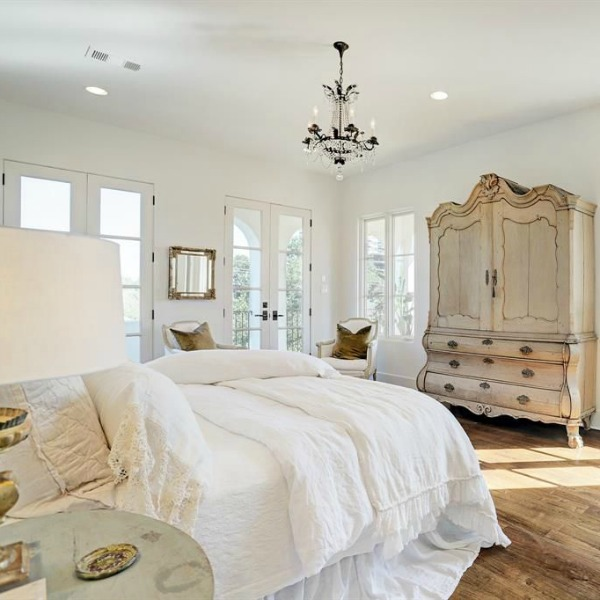 Oh the unforgettable timeless design of a white French bedroom in this home on Berthea in Houston. #interiordesign #luxuryhome #Europeanstyle #whitedecor