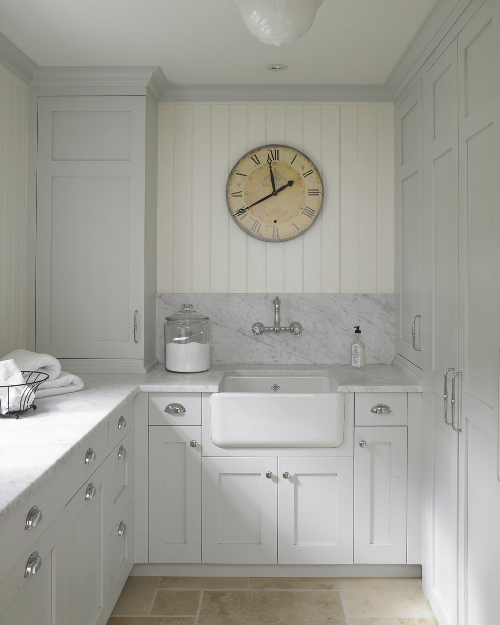 Classic English country laundry room with pale colors and a serene mood. Huestis Tucker Architects. Come enjoy Traditional Laundry Room and Mud Room Design Ideas, Resources, and Humor Quotes!