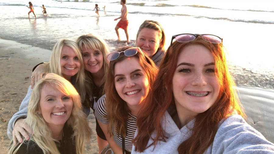 Reflections from a Previvor - Six women smiling at the beach - Hello Lovely Studio. Come hear about What It's Like Living With Breast Cancer Genetic Mutation: Soulful Reflections From a Previvor As Well As Information About BRCA and Hereditary Cancer.