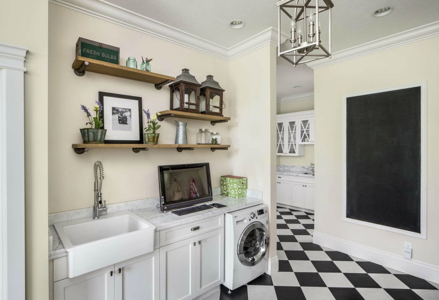 Timeless design, sophisticated decor, and exceptional architecture in this laundry room space by The Fox Group.