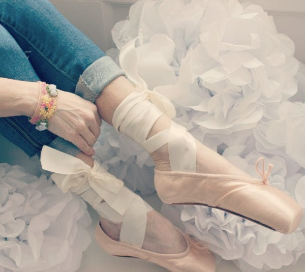 Reflections from a Previvor - Michele in pointe shoes - Hello Lovely Studio. Come hear about What It's Like Living With Breast Cancer Genetic Mutation: Soulful Reflections From a Previvor As Well As Information About BRCA and Hereditary Cancer.
