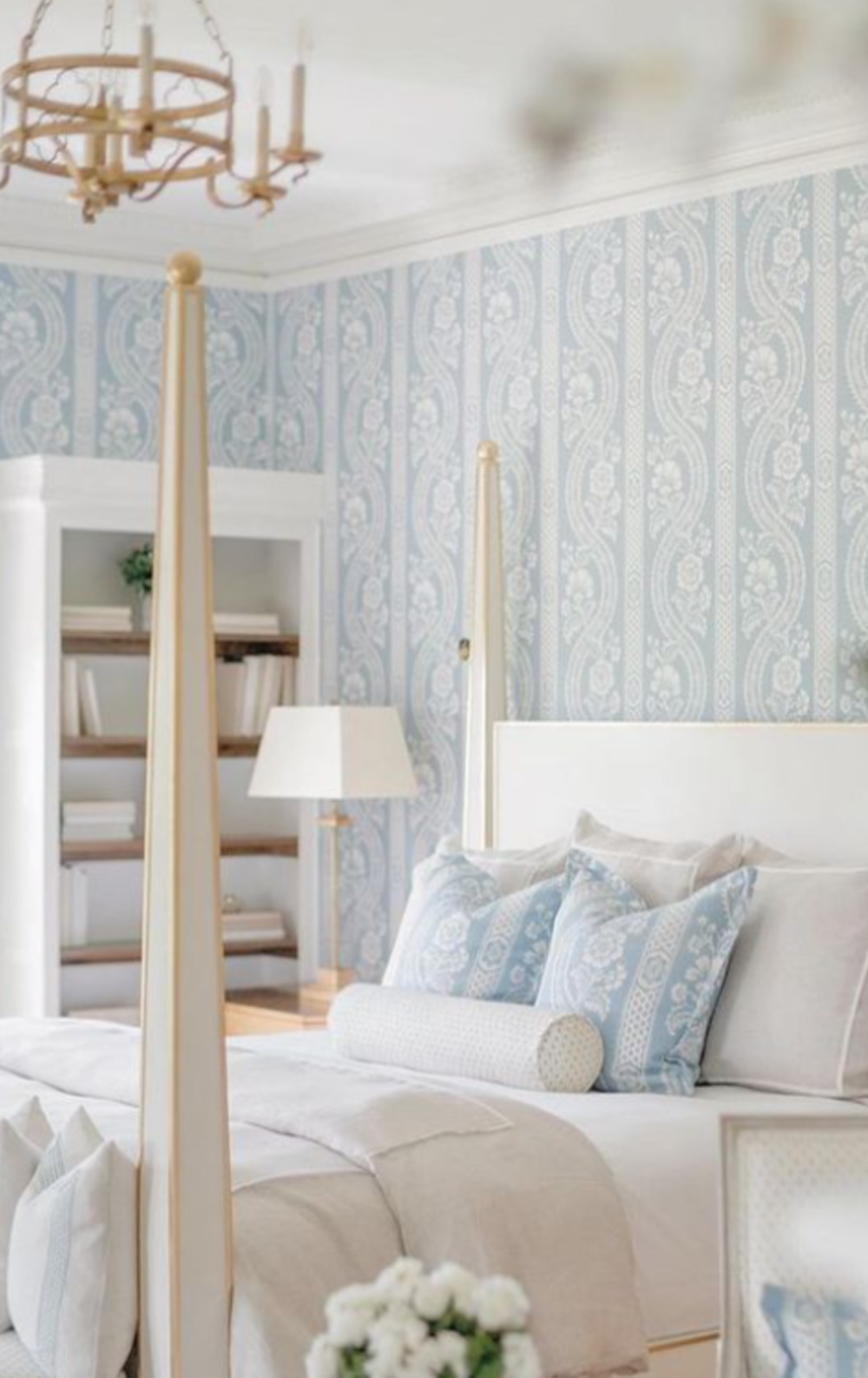 Timeless traditional interior design style in a blue wallpapered serene bedroom in Vermont by The Fox Group. #chambrayblue #bedroom #interiordesign