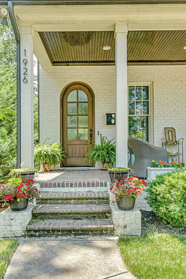 This charming home exterior in Charlotte, NC, boasts curb appeal, traditional design, and inspiring architectural details - Hello Lovely Studio.