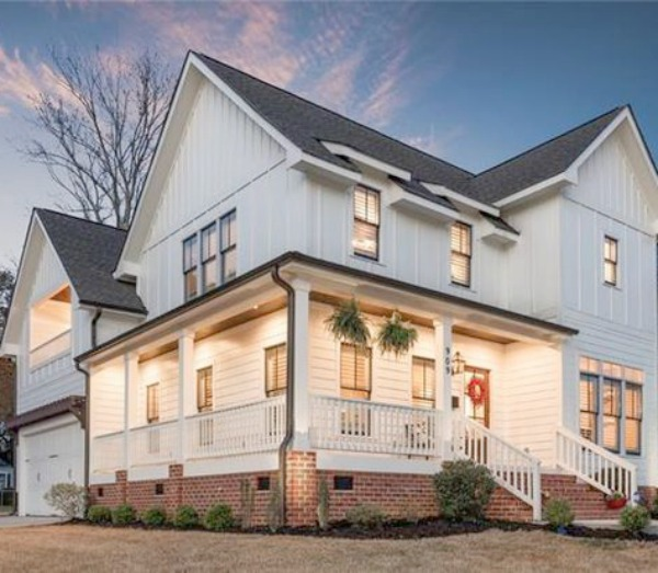 Stunning white farmhouse with wrap around porch in Charlotte, North Carolina.