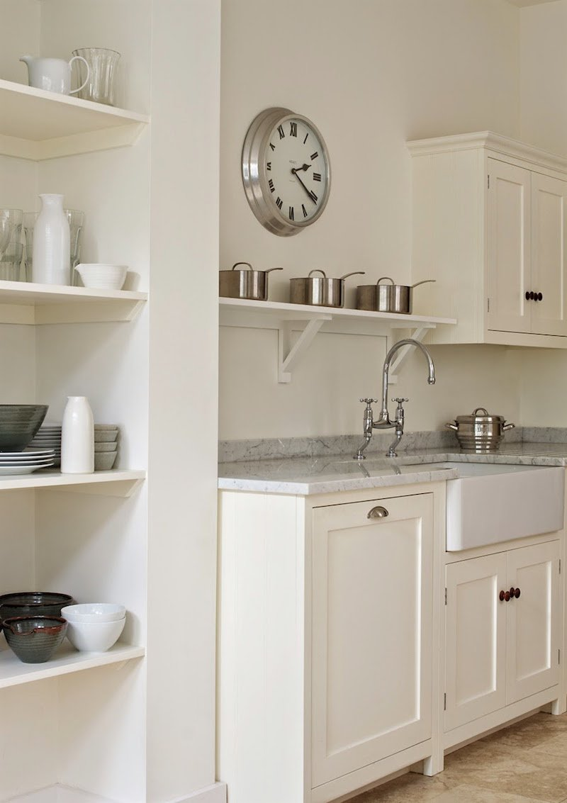 Farrow and Ball's Wimborne White paint is magical on these Shaker kitchen cabinets by bespoke furniture maker deVOL.