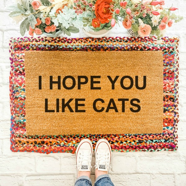 "Crazy cat lovers and canoodlers of cozy kittens rejoice - you've just found the perfect mat for your front door! ""I hope you like cats' is handpainted on a natural coir doormat. #catlover #doormat #layeredrugs"