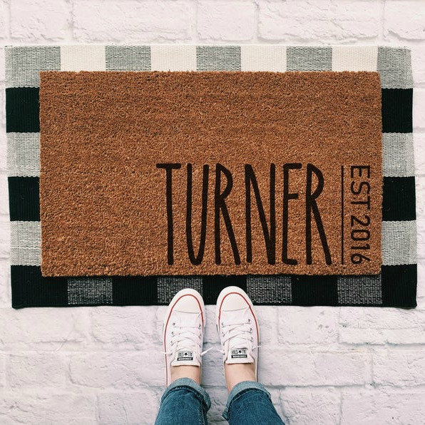 Only the best family gift for the holidays or engagement or newlywed gift! Personalized door mat with last name and anniversary. Rug layering is still adorable! #doormat #ruglayering