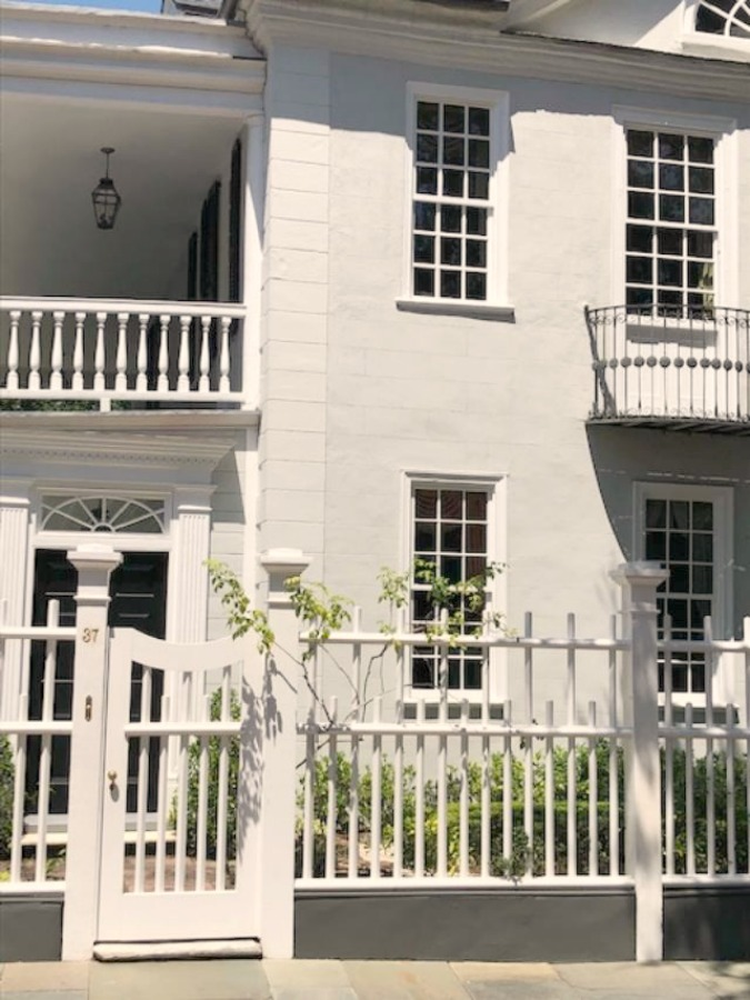 In the Battery area of Charleston, beautiful antebellum mansions with charming gardens, gates, and colorful front doors inspire with their curb appeal - Hello Lovely Studio