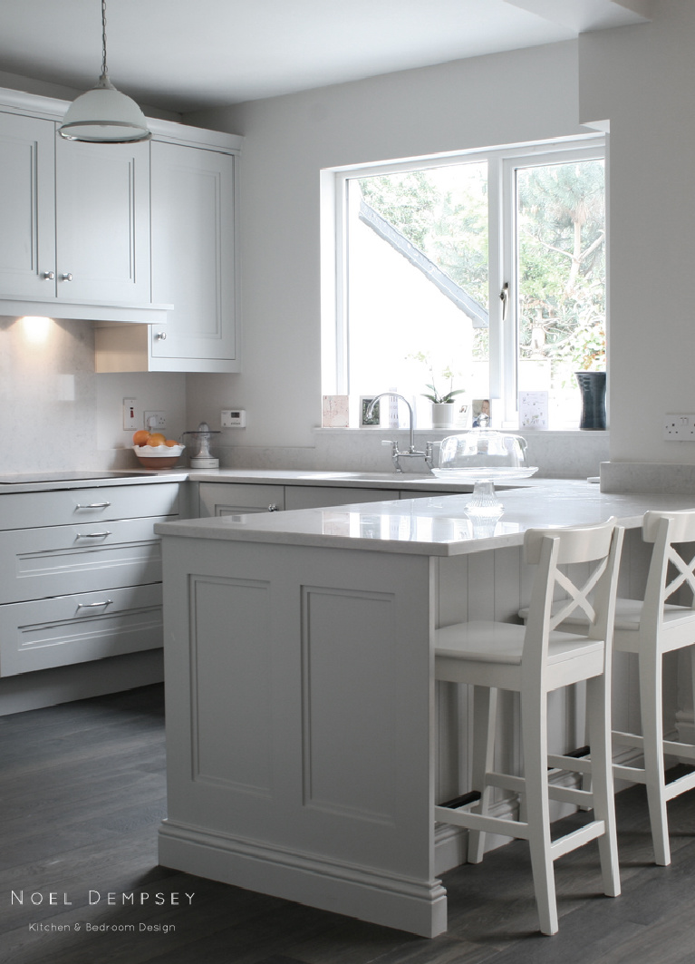 Farrow & Ball Pavilion Gray paint color on cabinets in an exquisite kitchen by Noel Dempsey. #paintcolors #farrowandball #paviliongray #graycabinets #graykitchens