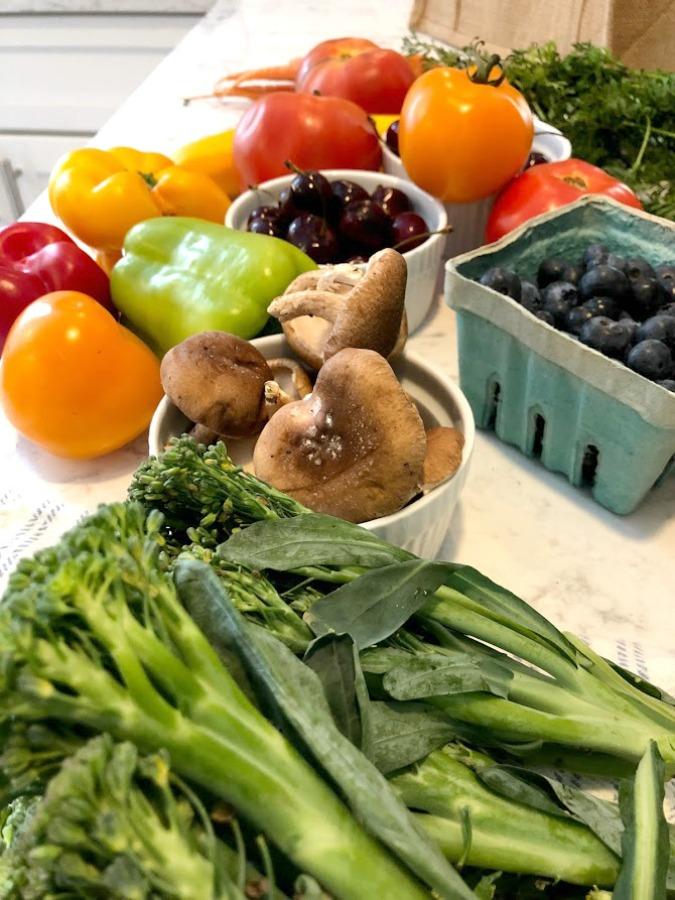 Fresh vegetables and fruit from the farmer's market in summer - Hello Lovely Studio.