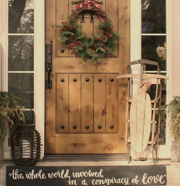 Christmas wreath on my front door with a vintage sled and wood lantern - Hello Lovely Studio. CLICK OVER to find Christmas Decor DIY Ideas to Get Crafting for the Holidays Right Now as well as Decorating ideas! #christmasdecor