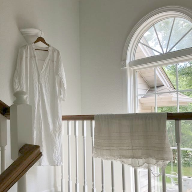 Antique white cotton clothing drying in the sun - Hello Lovely Studio.