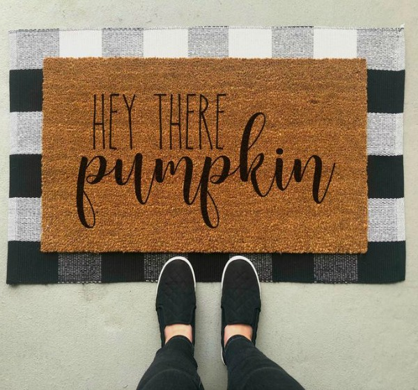 "Layered doormat with ""Hey There Pumpkin"" mat over a black and white buffalo check rug...fall front door magic!"