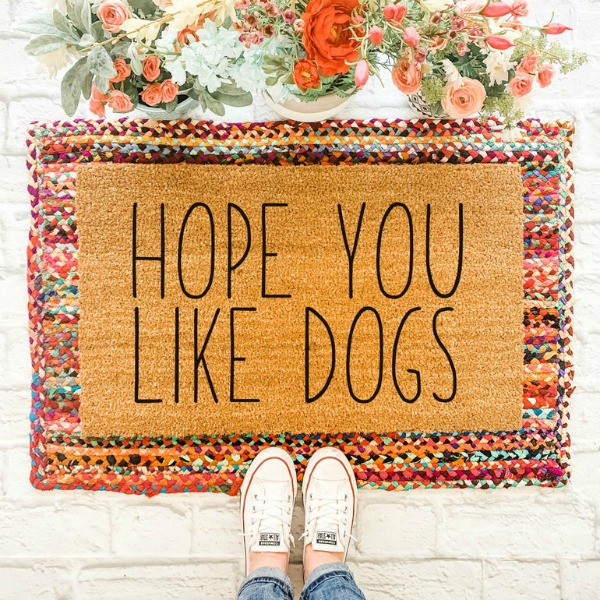 "Layered doormat with ""Hope You Like Dog"" mat over a colorful braided rag rug...fall front door magic! #doglovers #layereddoormat"