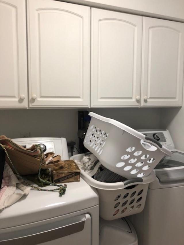 Before pic of laundry room in fixer upper.