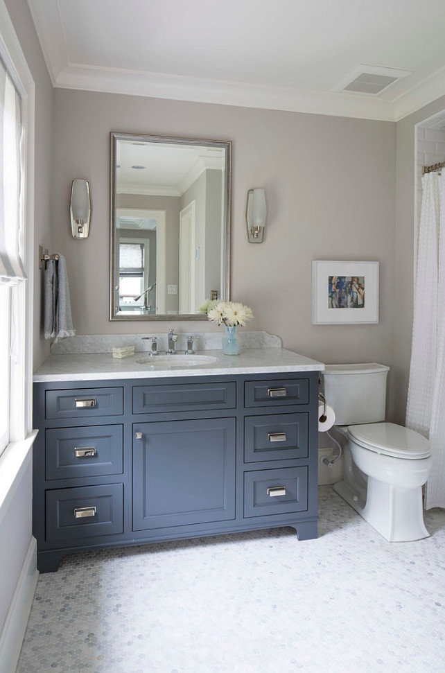 Beautiful navy blue bathroom vanity painted Farrow and Ball French Beret (a navy blue) and walls painted Cornforth White. Martha O'Hara Interiors.