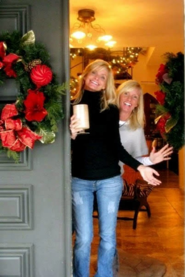 Reflections from a Previvor - Blonde women at front door with holiday wreath - Hello Lovely Studio. Come hear about What It's Like Living With Breast Cancer Genetic Mutation: Soulful Reflections From a Previvor As Well As Information About BRCA and Hereditary Cancer.