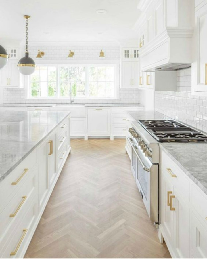 Timeless design, sophisticated decor, and exceptional architecture in this classic kitchen with herringbone flooring by The Fox Group.  Click through for 9 Tranquil, Traditional, Timeless Interior Design Ideas & Inspiring House Exteriors: The Fox Group!