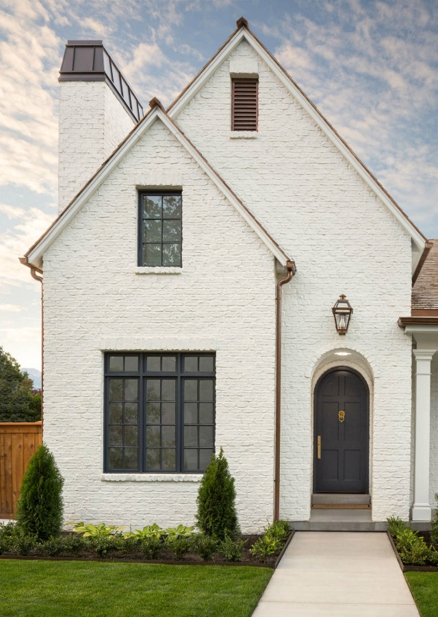 White painted brick beautiful home exterior by The Fox Group. Come discover White Homes + A Few Bright White Exterior Paint Colors