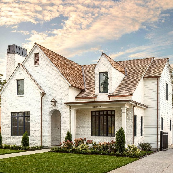 White painted brick exterior of Modern Tudor home by The Fox Group. Click through for 9 Tranquil, Traditional, Timeless Interior Design Ideas & Inspiring House Exteriors: The Fox Group!