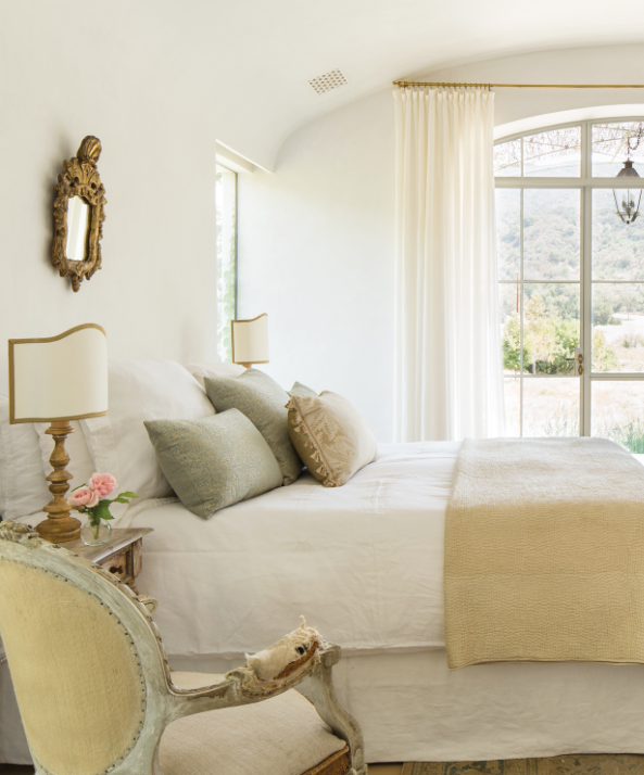 Patina Farm master bedroom by Giannetti Home is a study in European country elegance with California organic simplicity. Photo: Velvet and Linen. #patinafarm #masterbedroom #serenedecor #frenchfarmhouse #europeancountry #whitedecor #zenbedroom #romanticbedroom #giannettihome