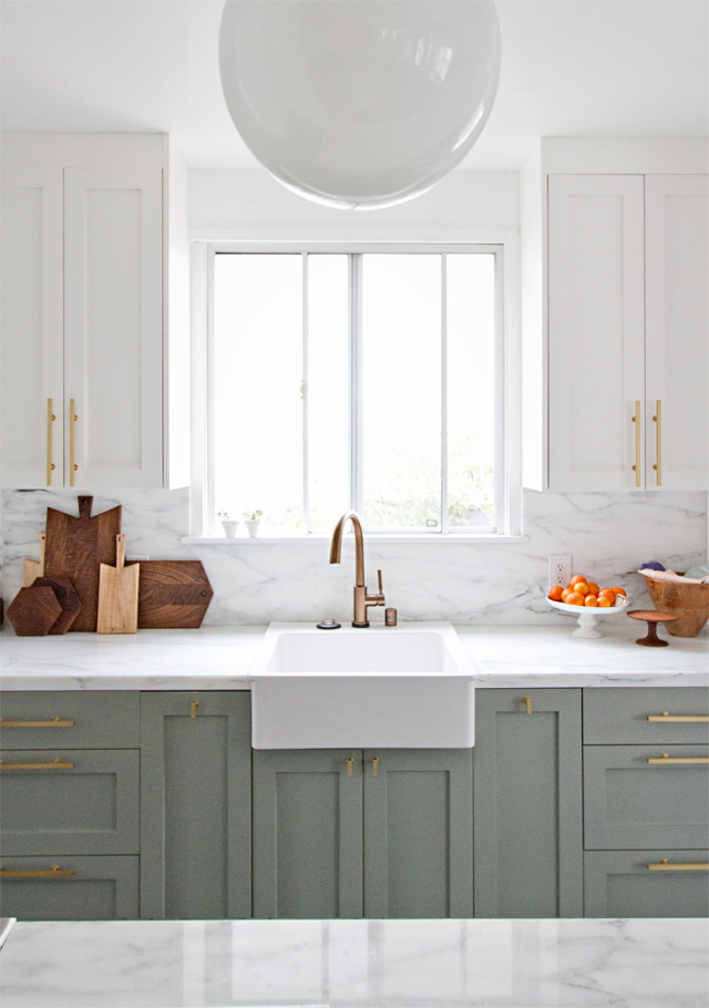 Sarah Sherman Samuel's kitchen renovation is a relevation with Wimborne White painted upper cabinets (Farrow & Ball).